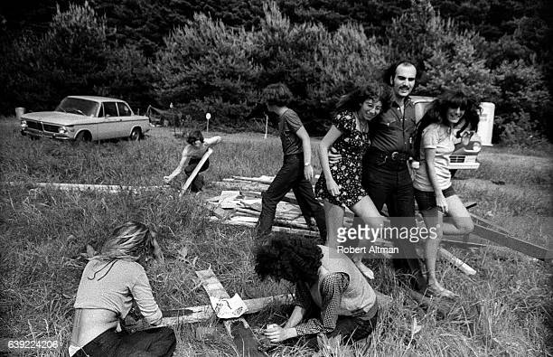 A man walks with two women during the Alternative Media Conference at Goddard College in June 1720 1970 in Plainfield Vermont