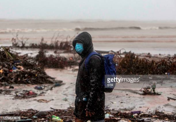 Man walsk at the beach in El Muelle neighbourhood in Bilwi, Puerto Cabezas, Nicaragua, on November 16, 2020 as Hurricane Iota -- upgraded to Category...