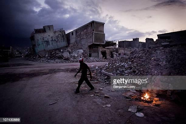 Man wanders through earthquake ravaged downtown Port au Prince, on February 11 2010. Haiti was struck by a magnitude 7 earthquake on January 12, 2010...