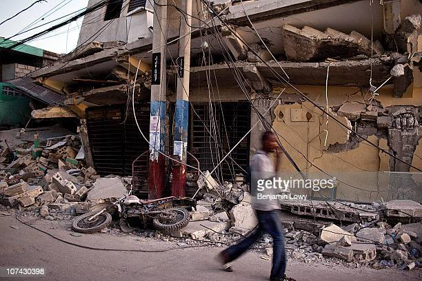 Man wanders through the remains of earthquake ravaged downtown Port au Prince, Haiti. On January 12, 2010 Haiti was struck by a magnitude 7...