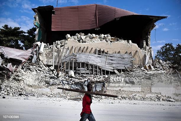 A man wanders through the remains of earthquake ravaged Port au Prince Haiti on January 31 2010 On January 12 2010 Haiti was struck by a magnitude 7...