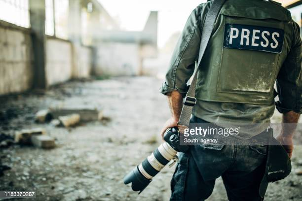 man war journalist with camera - war stock pictures, royalty-free photos & images