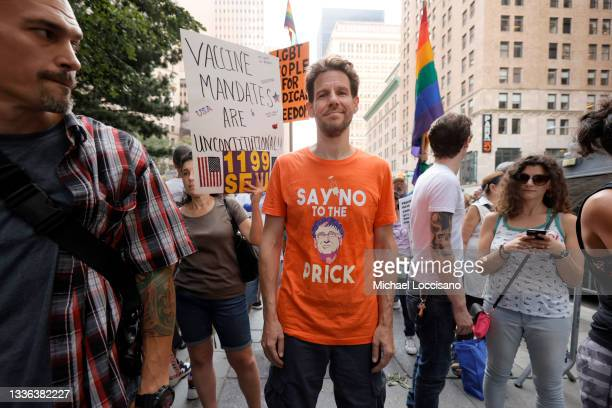 Man waring an anti-vaccination T-shirt protests with the NY Unions for Choice against vaccine mandates at City Hall on August 25, 2021 in New York...