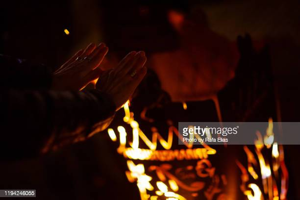 man warming his hands at the stake - warming up stock pictures, royalty-free photos & images