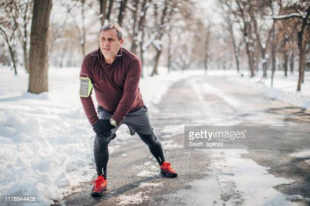 man warming up before jogging - warm up exercise stock pictures, royalty-free photos & images