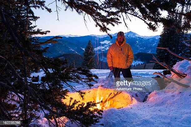 Man Warming Up in Winter by Fire