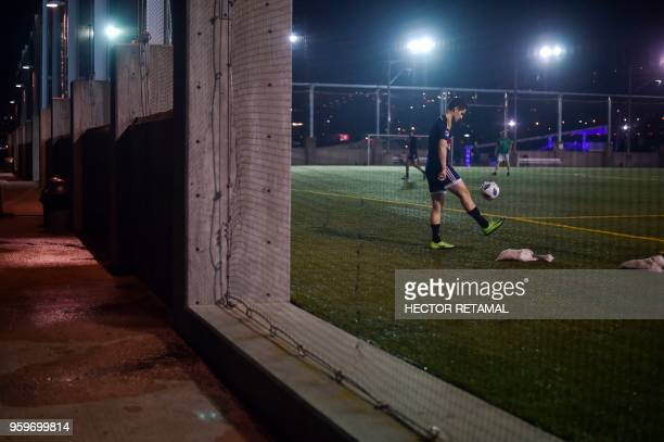A man warms up before playing soccer at Brooklyn Bridge Park in New York City on May 17 2018