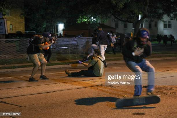 Man was shot in the chest as clashes between protesters and armed civilians who protect the streets of Kenosha against the arson during the third day...