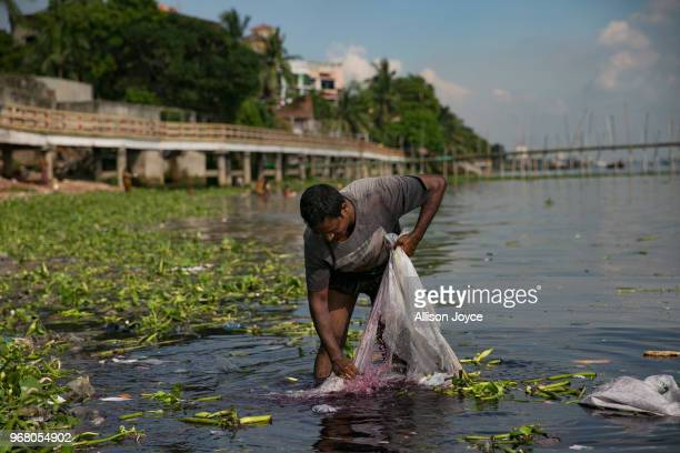 A man washes a chemically treated plastic bag in the Buriganga river on June 5 2018 in Dhaka Bangladesh Bangladesh has been reportedly ranked 10th...