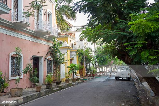 A man washes an Ambassador car in the early morning in a Colonial street Pondicherry India Pondicherry is a Union Territory of India and was a French...