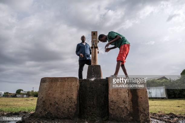 Man washes his face at a water well in the outskirts of the city of Bahir Dar, northern Ethiopia, on June 18, 2021.