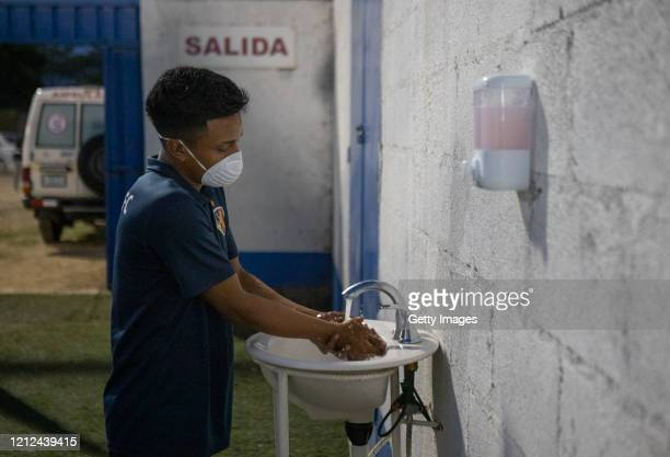 Man washes his hands as he enters to the stadium prior the final match between Managua FC and Real Estelí as part of Nicaraguan Liga Primera at...