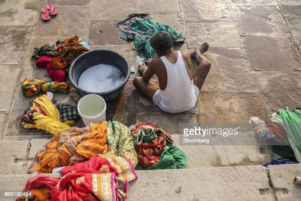 A man washes laundry on the banks of the Ganges river in Varanasi Uttar Pradesh India on Saturday Oct 29 2017 A big drop in borrowing costs for...