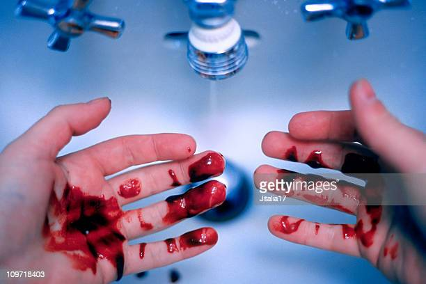 Man Washing Blood off Hands - Murder/Guilt Concept