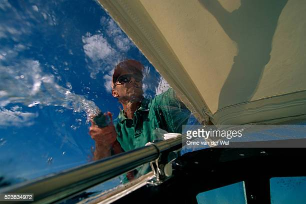 man washing boat - straw boater hat stock pictures, royalty-free photos & images