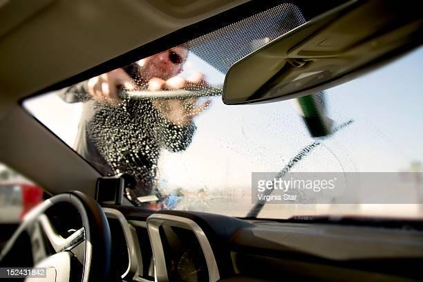 Man washing  car windscreen