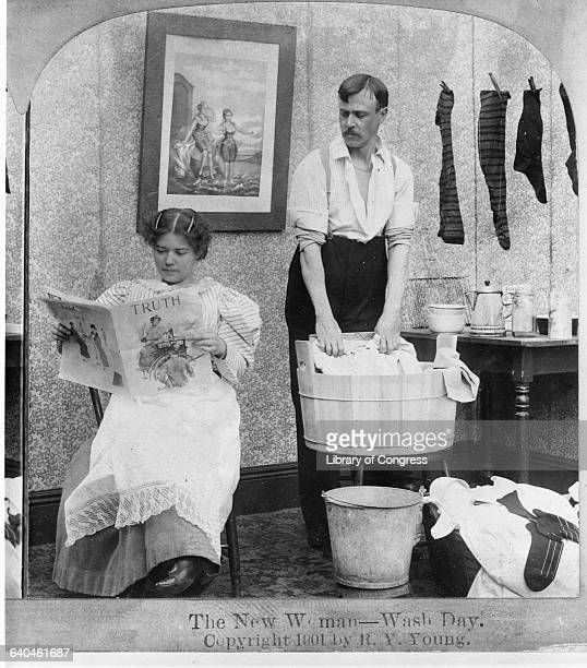 Man Washing Clothes as Woman Reads