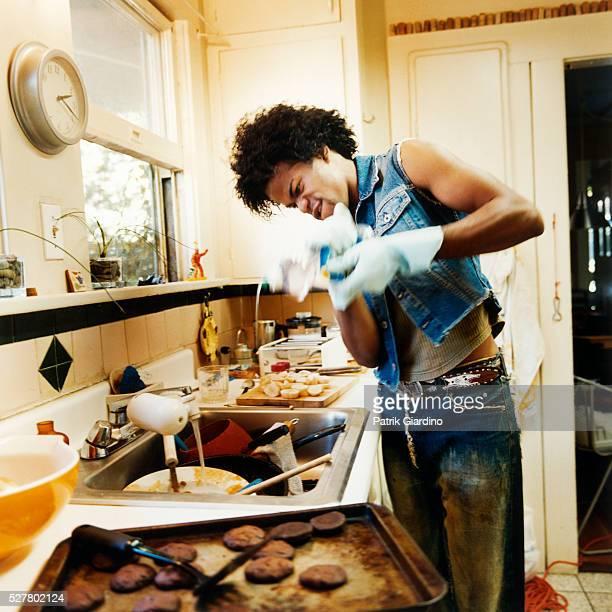 Man Washing Dirty Dishes
