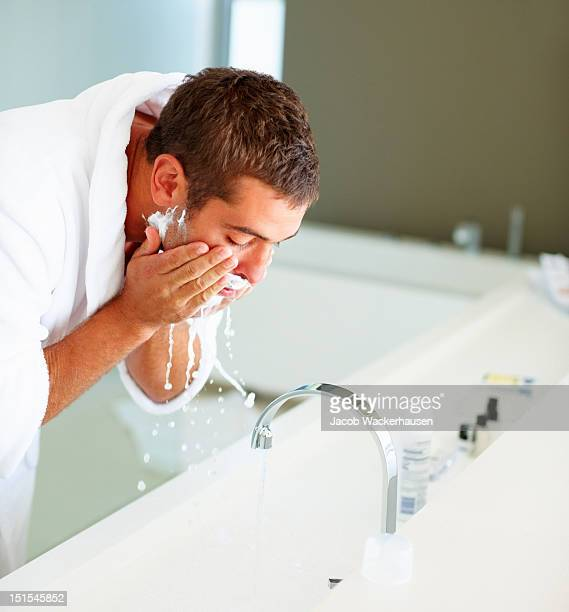 Man washing face after shaving