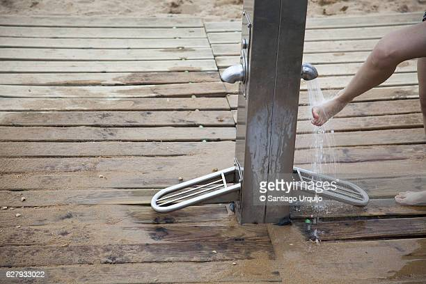 Man washing feet in outdoor shower