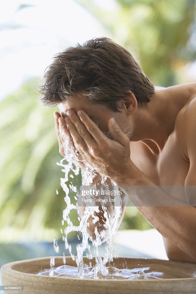 Man Washing His Face : Stock Photo