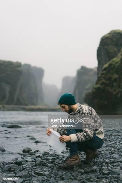 Man washing near the river in Fjaðrárgljúfur canyon