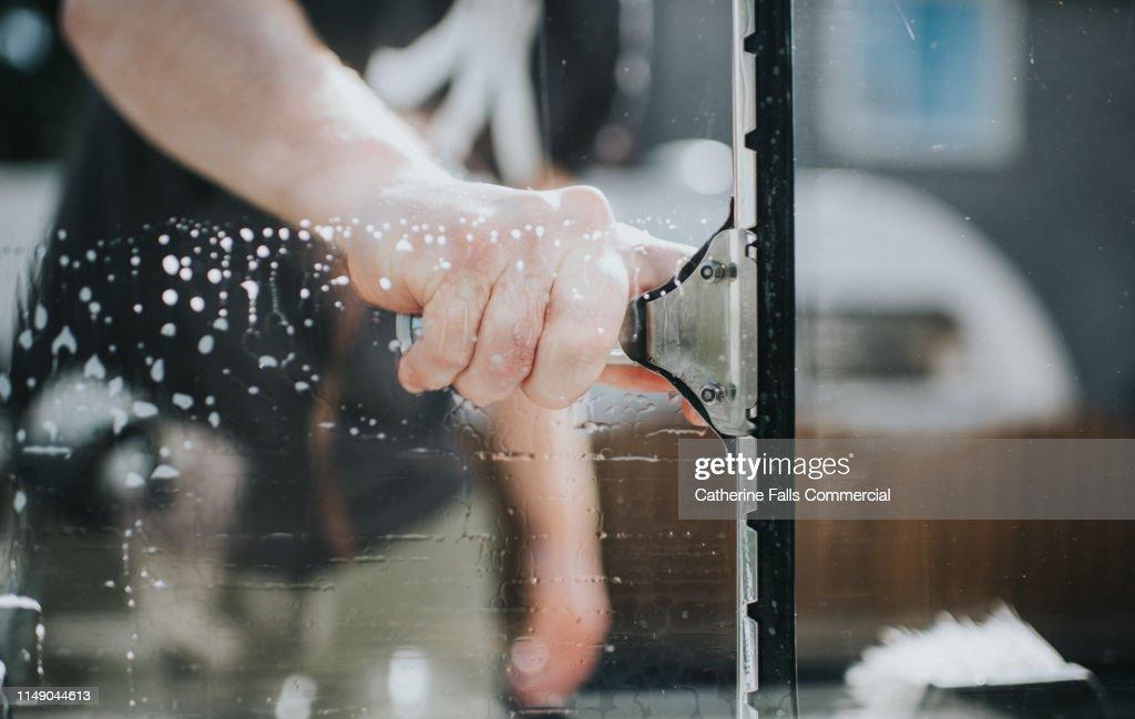 Man washing Window : Stock Photo