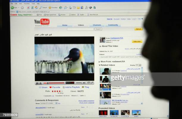 A man watches a clip on the popular videosharing website YouTube which mocks radical Shiie cleric Moqtada alSadr in Baghdad 29 January 2008 US...