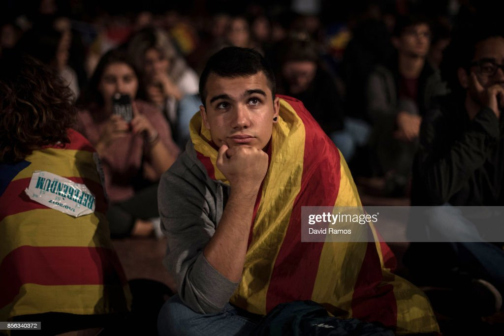 A man watches a large screen showing the speech of the Spain's Prime Minister Mariano Rajoy at Plaza Catalunya on October 1, 2017 in Barcelona, Spain. More than five million elegible Catalan voters are estimated to visit 2,315 polling stations today for the Catalonia's referendum on independence from Spain. The Spanish government in Madrid has declared the vote illegal and undemocratic.