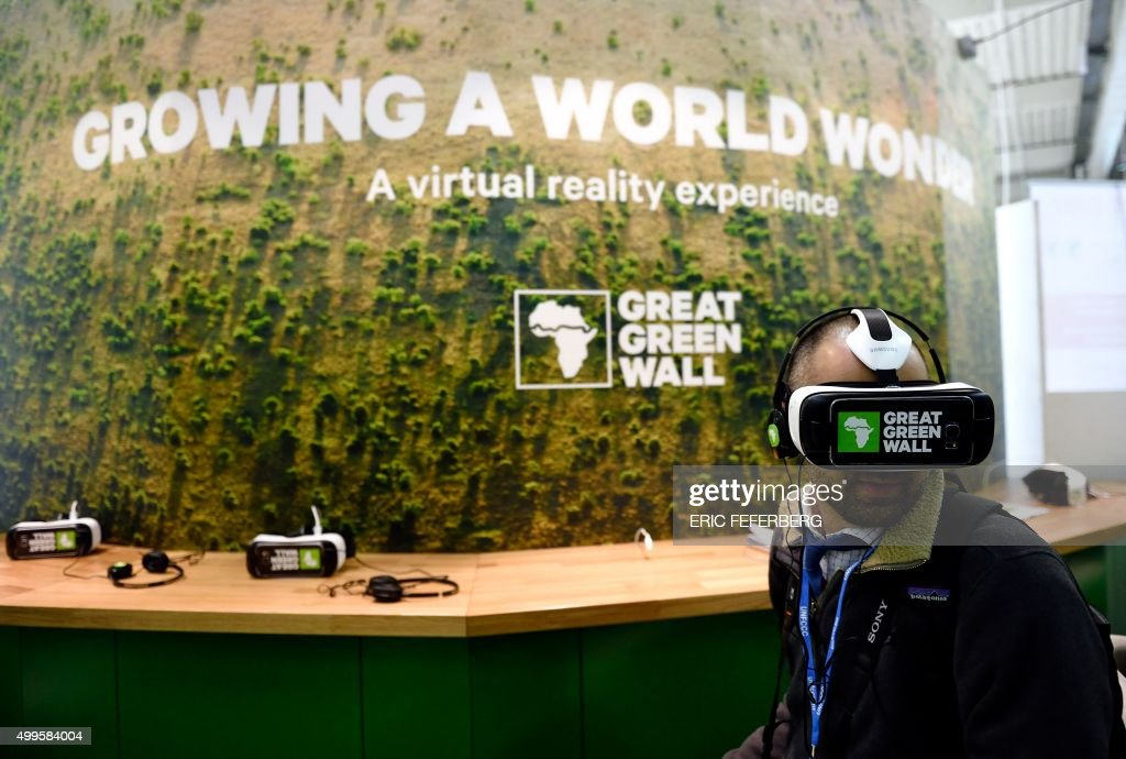 A man watches a movie with 3D glasses about the Great Green Wall in Africa at the Chad stand during the COP21 United Nations Conference on climate change, on December 2, 2015 at Le Bourget, northeastern suburbs of Paris. Campaigners on December 2, 2015 pointed a finger at the rich for dangerous warming of the planet as negotiators from 195 nations fought a grinding battle over the text of a pact to avert climate disaster. / AFP / Eric FEFERBERG