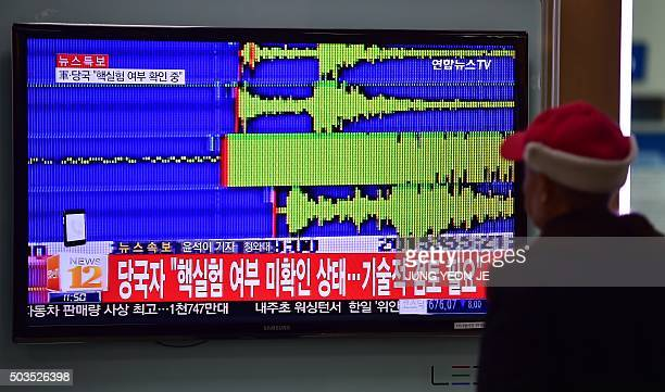 A man watches a news report at a railroad station in Seoul on January 6 after seismologists detected a 51 magnitude tremor next to North Korea's main...
