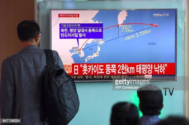 TOPSHOT A man watches a screen showing a graphic of a North Korean missile launch at a railway station in Seoul on September 15 2017 North Korea...