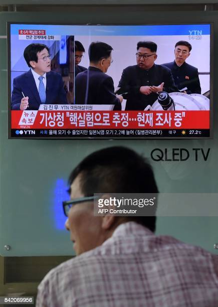 Man watches a television display at a train station in Seoul on September 3, 2017 showing a news broadcast about North Korea's latest possible...