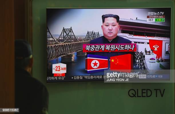 A man watches a television news about a suspected visit to China by North Korean leader Kim Jong Un at a railway station in Seoul on March 27 2018...
