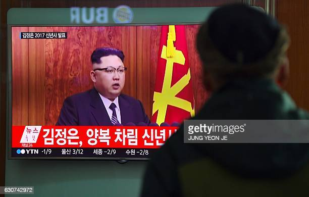 A man watches a television news broadcast at a railway station in Seoul on January 1 2017 showing North Korean leader Kim JongUn's New Year's speech...