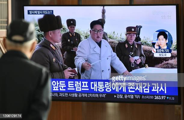 A man watches a television news broadcast showing file footage of North Korea's leader Kim Jong Un at a railway station in Seoul on March 9 2020...