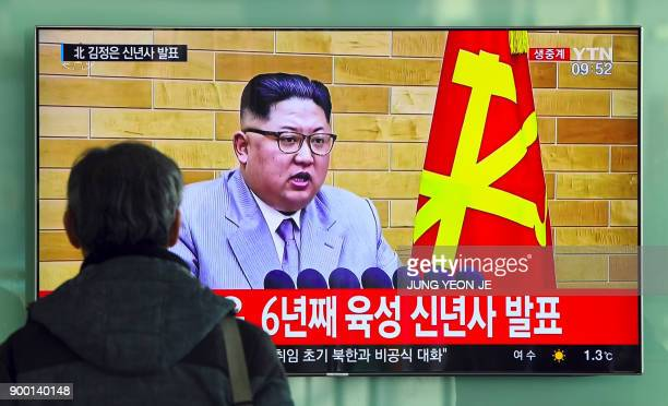 TOPSHOT A man watches a television news broadcast showing North Korean leader Kim JongUn's New Year's speech at a railway station in Seoul on January...