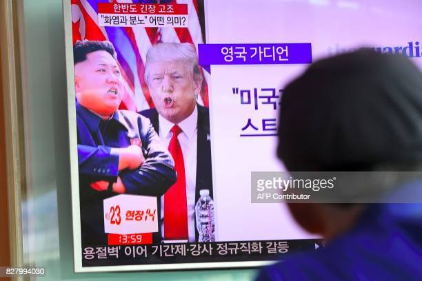 A man watches a television news programme showing US President Donald Trump and North Korean leader Kim JongUn at a railway station in Seoul on...