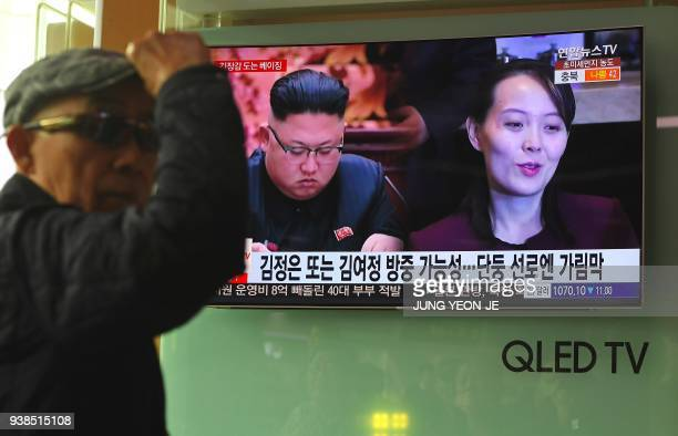 A man watches a television news report about a suspected visit to China by North Korean leader Kim Jong Un at a railway station in Seoul on March 27...