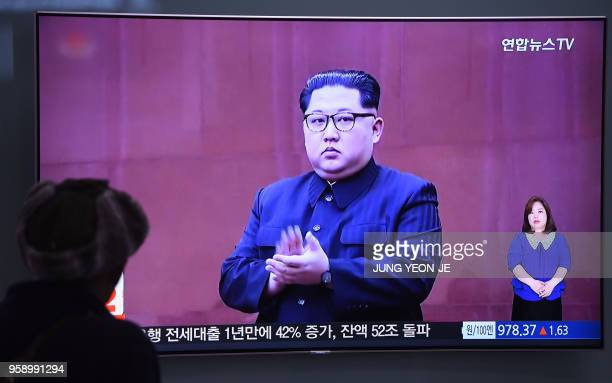 A man watches a television news screen showing North Korean leader Kim Jong Un at a railway station in Seoul on May 16 2018 North Korea threatened on...