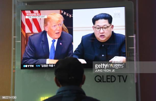 A man watches a television news screen showing US President Donald Trump and North Korean leader Kim Jong Un at a railway station in Seoul on May 25...