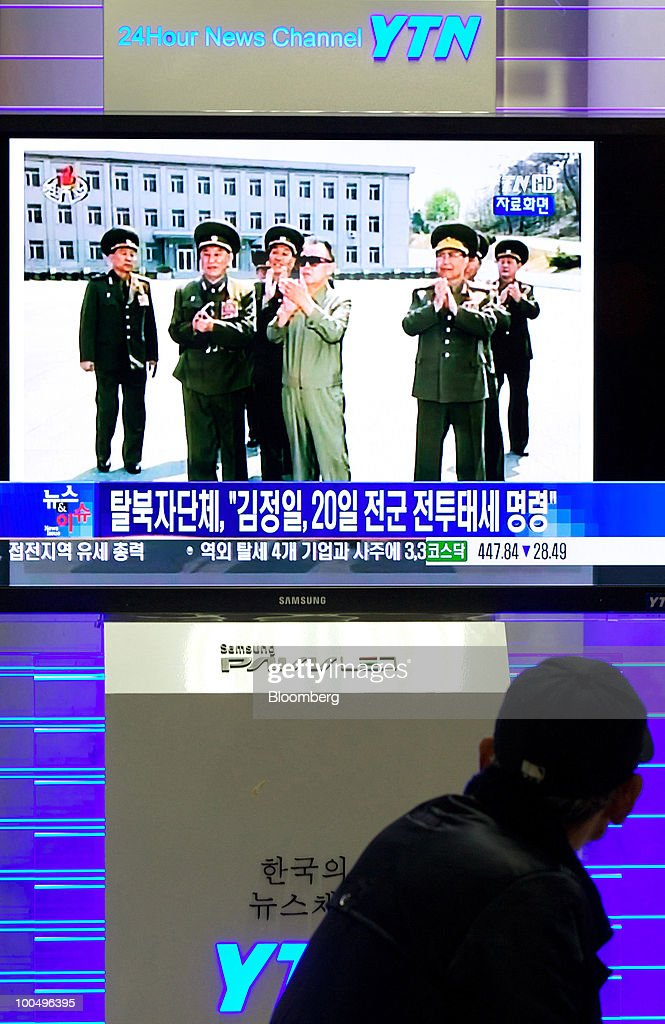 A man watches a television program showing North Korean leader Kim Jong Il, at Seoul Station in Seoul, South Korea, on Tuesday, May 25, 2010. Asian stocks and the won plunged to 10-month lows after a report that Kim ordered his military to prepare for combat last week. Photographer: SeongJoon Cho/Bloomberg via Getty Images
