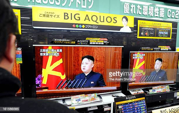 A man watches a televsion broadcasting reporting the North Korea's nuclear test at an electronics store on February 12 2013 in Tokyo Japan North...