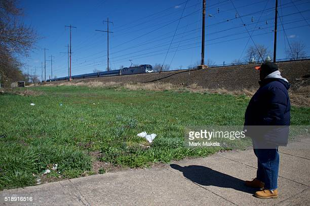 A man watches an Amtrak train resume service as it proceeds at reduced speed towards the crash site of Amtrak Palmetto train 89 on April 3 2016 in...