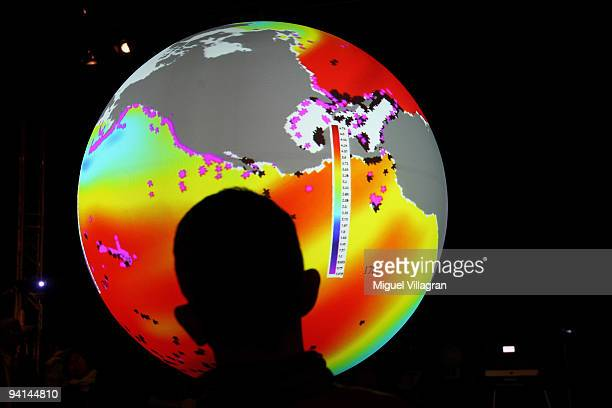 A man watches an animated projection showing the different acidity of the ocean inside the US Center 09 during the second day of the United Nations...
