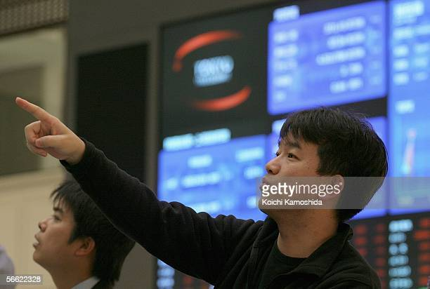 A man watches an electronic share price display at the Tokyo Stock Exchange January 19 2006 in Tokyo Japan For the first time the Tokyo Stock...