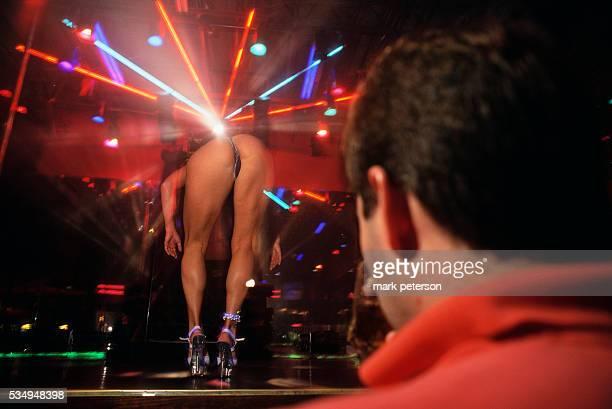 A man watches an exotic dancer at the Diamond Club a striptease club in Charlotte North Carolina