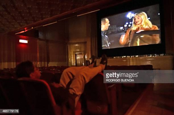 A man watches an XXX rated movie at the Hollywood porno cinema in downtown Quito on March 6 2015 A handfull of men practically the same go regularly...
