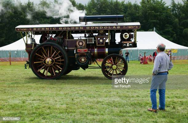 A man watches as a steam engine is driven across the showground during the Duncombe Park Steam Rally on July 1 2017 in Helmsley United Kingdom Held...
