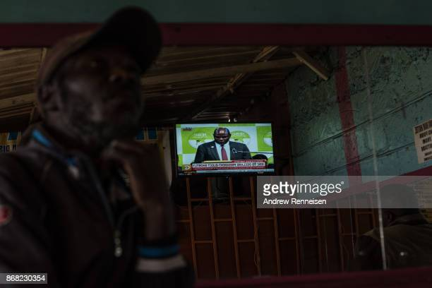 A man watches as election results are announced in the Mathare slum on October 30 2017 in Nairobi Kenya Uhuru Kenyatta was named to his second term...